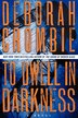 To Dwell In Darkness: A Novel