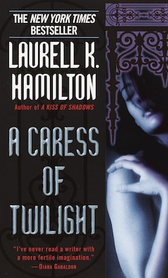 Book A Caress of Twilight by Laurell K. Hamilton