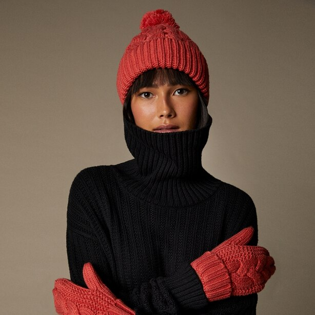 LOVE AND LORE SUSTAINABLE STYLE ECO CABLE KNIT POM HAT CORAL